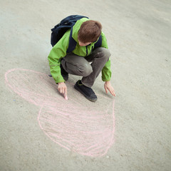 Boy drawing on road