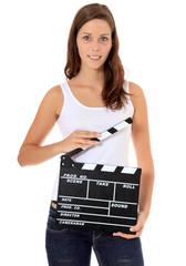 Attraktives Mädchen mit Filmklappe