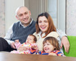 joyful family of four at their home