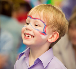 boy with painted face playing