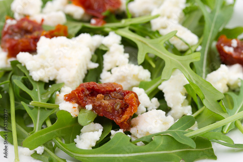 rucola with cheese and tomato