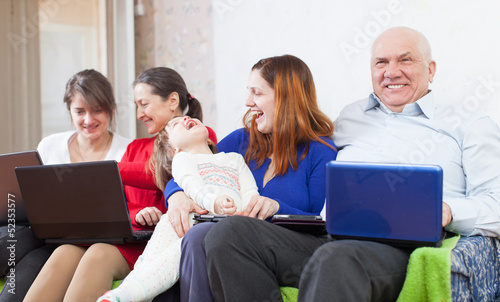 Happy family uses few   devices