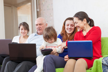multigeneration family using laptops