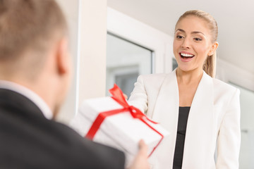 A man giving a gift