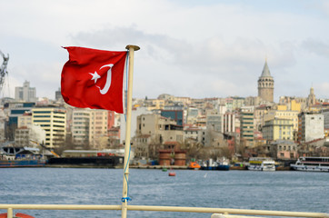 Galata tower with waving turkish flag