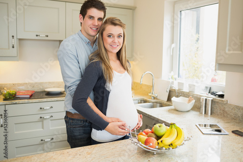 Man with  pregnant wife in the kitchen