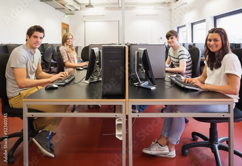 Happy students in computer room