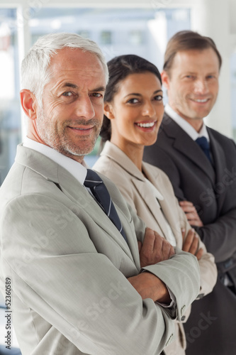 Cheerful business people looking in the same way