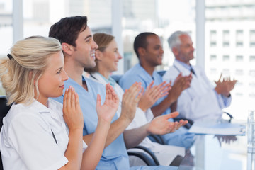Medical team clapping hands