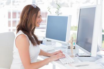 Attractive designer working at computer