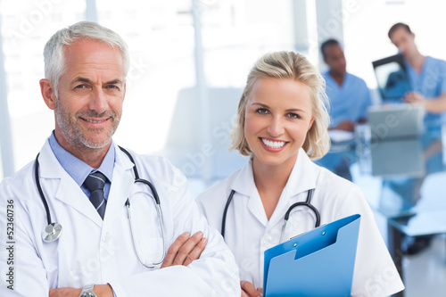 Doctors holding blue file