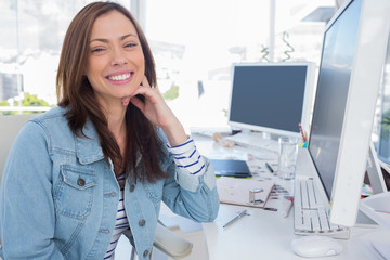 Attractive designer in creative office