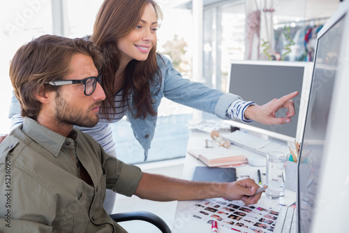 Colleague pointing photo out to editor