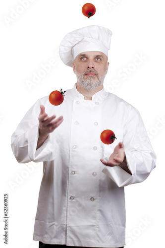 Cook juggles tomatoes