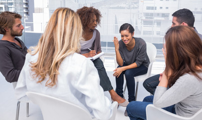 Woman getting depressed in group therapy