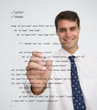 Smiling businessman writing in sql language
