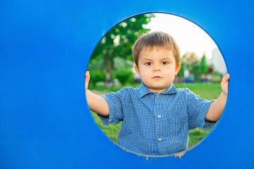 Little boy at playhouse