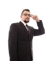 Isolated businessman touching her glasses.