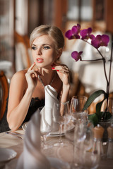 beautiful blonde woman in cafe restaurant