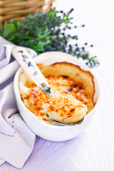 Boiled eggs baked with sauce and cheese (Gratin provencal eggs)