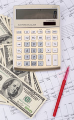 calculator with pen and dollars