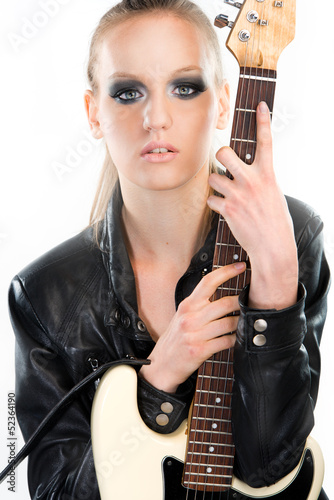 Beautiful rock girl holding a guitar