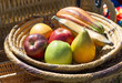 fake fruits for decoration in a wicker bowl