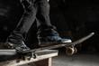 Skater balancing on edge on manual pad