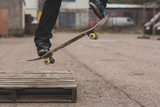Skater doing ollie off wooden crate