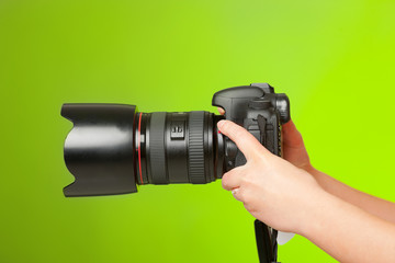 Photographer hands with camera