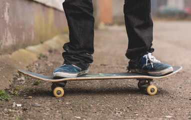 Skater standing on his board