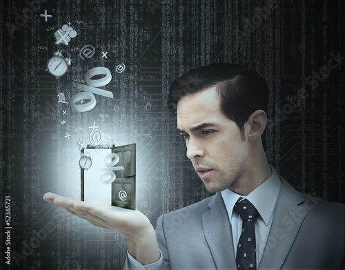 Concentrated businessman holding a door