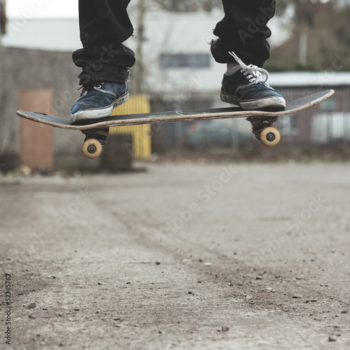 Skaters feet on board mid air
