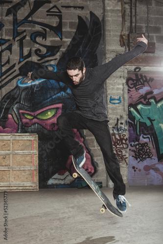 Skater doing impressive backside half cab 180 trick