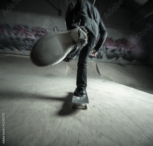 Skater pushing towards the ramp