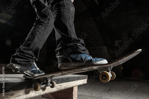 Skater balancing on edge on manual pad