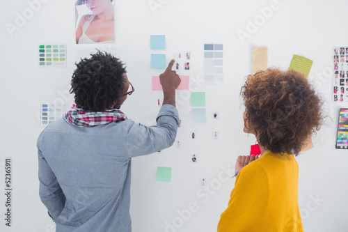 Designers pointing at a photo
