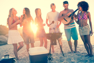 Friends cooking barbecue on the beach