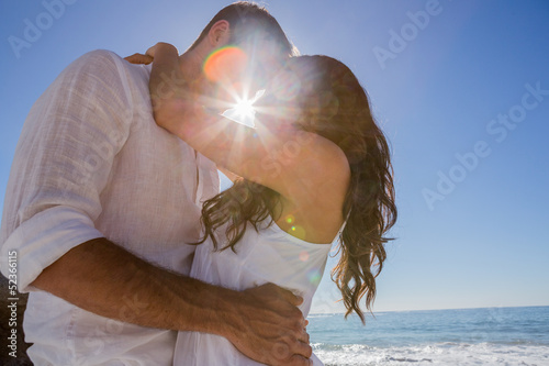 Romantic couple cuddling on the beach