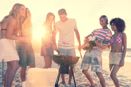 Friends having a barbecue on the beach