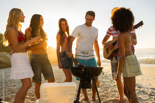 Group of young friends having a barbecue