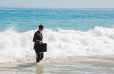 Businessman looking at the sea