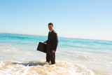 Businessman standing in the sea