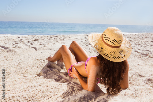 Brunette tanning on the beach