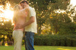 Beautiful couple kissing in a park