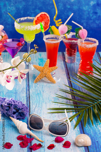 Foto op Canvas Caraïben colorful mixed cocktails in tropical blue wood
