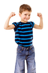 Strong kid showing the muscles
