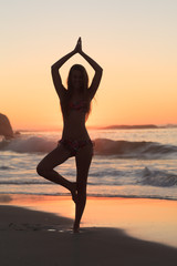 Sunset with woman doing yoga