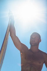 Attractive man holding surfboard