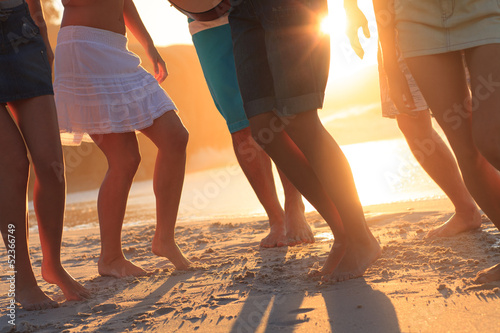 Group of people dancing on the beach